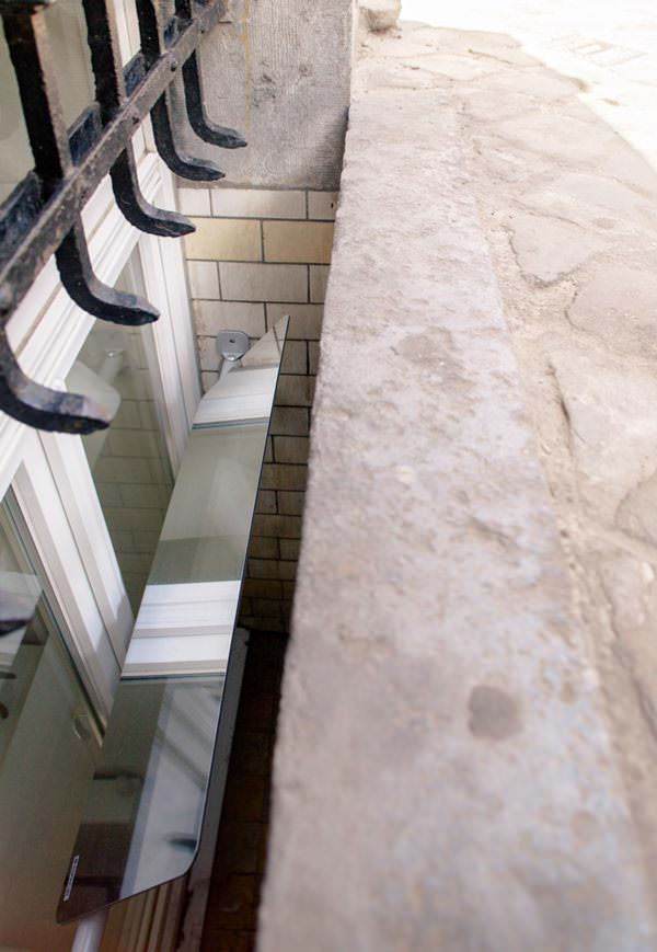 reflecteur-de-lumiere-espaciel-pour-apporter-de-la-lumiere-naturelle-dans-un appartement sombre-solution
